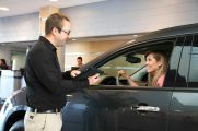 Service Advisor Kris Alderman greets a service customer